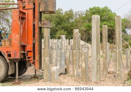 Pile Driver Driving Precast Concrete Piles On A Construction Site