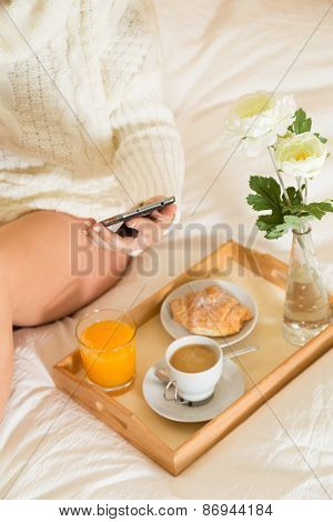 Woman Eating Breakfast In Bed