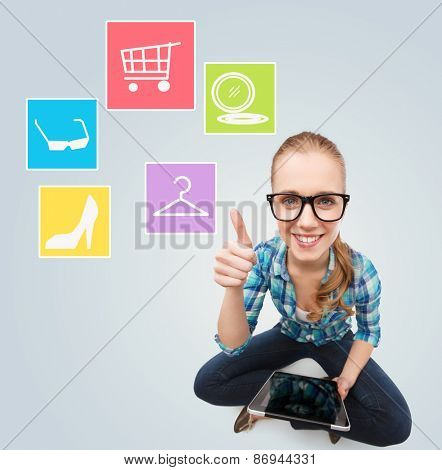technology, people, sale, fashion and internet concept - smiling woman sitting on couch with tablet pc computer shopping online over gray background