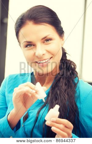 picture of beautiful woman polishing her nails