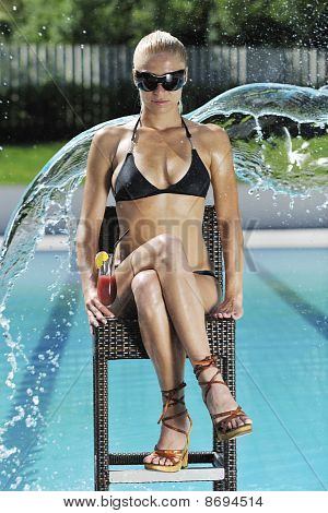 Woman Relax And Drink Coctail At Swimming Pool