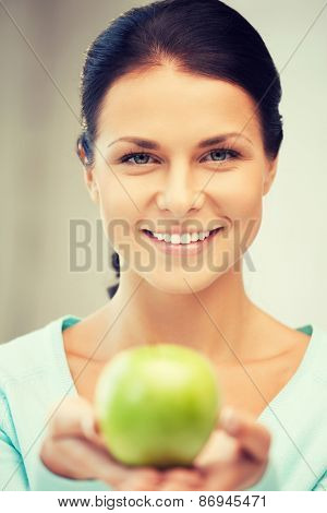 bright picture of lovely housewife with green apple