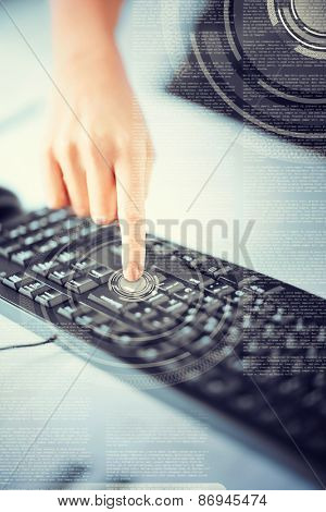business, education and technology concept - woman hand pressing on enter button on keyboard