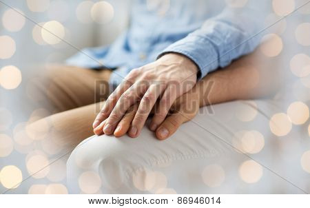 people, homosexuality, same-sex marriage, gay and love concept - close up of happy male gay couple holding hands