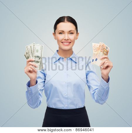 business, people, lottery, banking and finances concept - young businesswoman with dollar and euro cash money over blue background