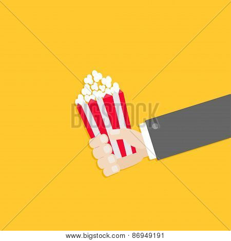 Popcorn. Businessman Hand. Cinema Icon In Flat Design Style.