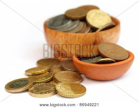 Old Coins Arranged In Bowls