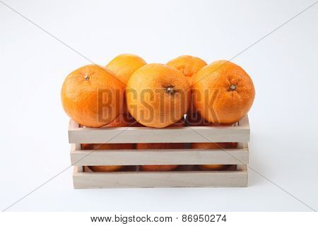 mandarin oranges in the wooden  container