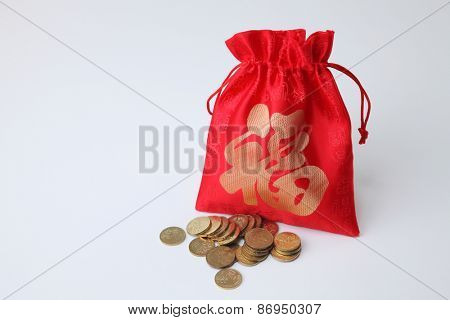lucky bag with money by the side