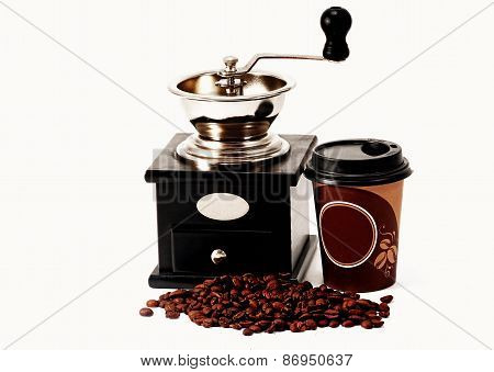 Coffee Grinder, Coffee Beans And Coffee Cup
