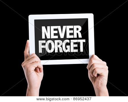 Tablet pc with text Never Forget isolated on black background