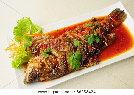 Thai style deep fried fish in chili sweet sauce