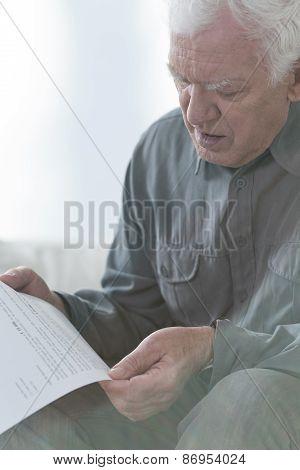 Senior Man Reading Document