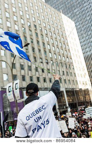 Separatist Protester Holding The Fleur De Lys Quebec Province Flag