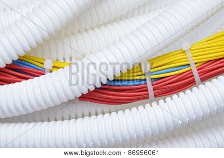 Corrugated pipe with electrical cables