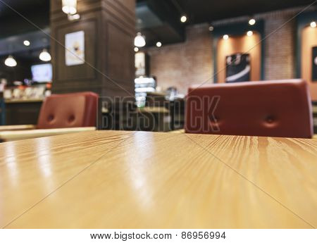 Top Of Table With Blurred Bar Restaurant Interior Background