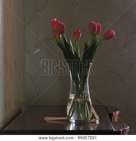 Bouquet Of Pink Tulips In A Transparent Vase