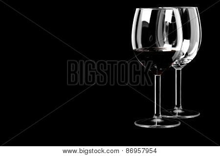 Wine glasses on a black background in the horizontal format