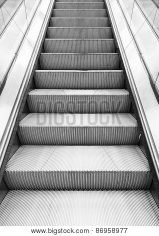 Shining Metal Escalator Moving Up, Vertical Photo