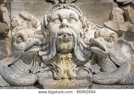 Sculpture on the Giacomo della Porta fountain in Rome, Italy