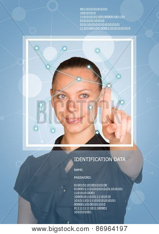 Concept of technology. Beautiful brunette in dress pointing finger on virtual grid