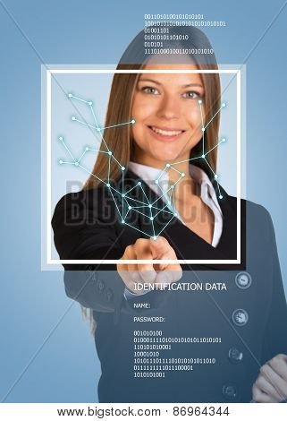 Beautiful blonde in suit pointing finger on virtual grid