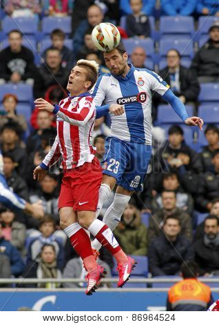 BARCELONA - MARCH, 14: Antoine Griezmann of Atletico Madrid Anaitz Arbilla of Espanyol headbutt during a Spanish League match at the Estadi Cornella on March 14, 2015 in Barcelona, Spain