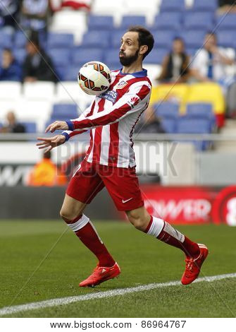 BARCELONA - MARCH, 14; Juanfran Torres of Atletico Madrid during a Spanish League match against RCD Espanyol at the Estadi Cornella on March 14, 2015 in Barcelona, Spain