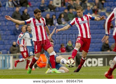 BARCELONA - MARCH, 14: Raul Garcia and Gabi Fernandez of Atletico Madrid during a Spanish League match against RCD Espanyol at the Estadi Cornella on March 14, 2015 in Barcelona, Spain