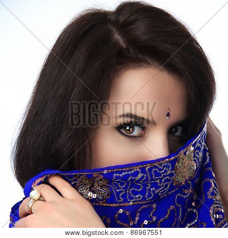 Young beautiful brunette woman in indian blue dress