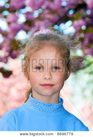 Happy Small Girl Portrait Near Blossoming Japanese Cherry Tree