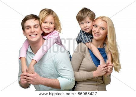 Smiling children riding piggyback on parents