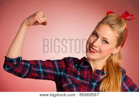 Beautiful Young Blond Pinup Woman Gesturing We Can Do It Over Red Background