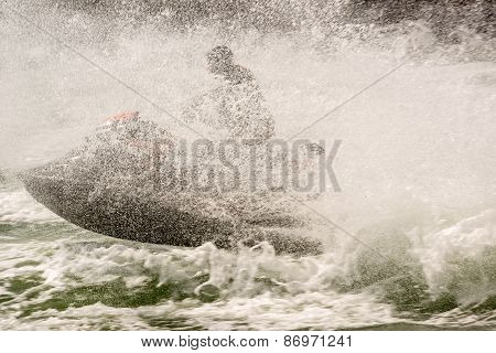 Jetski obscured by wake and spray