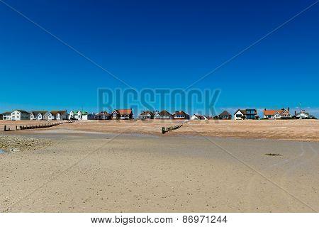 Houses line an empty beach