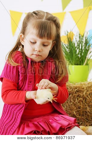 Girl Gently Stroking A Chicken
