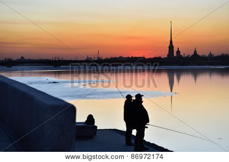 Fishing on the Neva river in Saint Petersburg, Russia in a spring evening