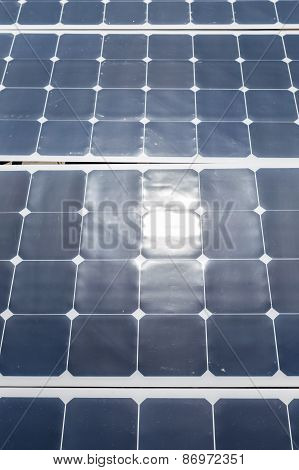 Close Up Of A Solar Panel With Sunlight Reflection