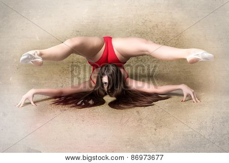 Young Female Contortionist, On Grunge Background