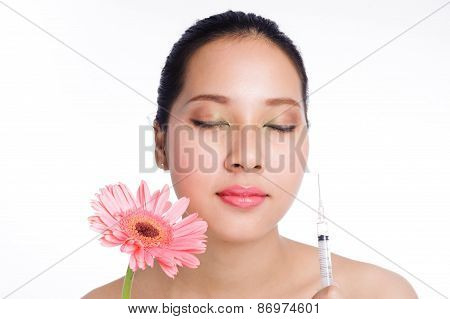Beautiful Woman With Syringe Botox And Flower