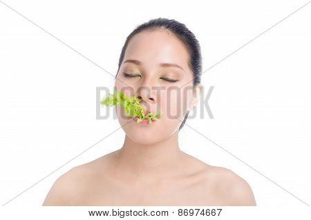 Beautiful Young Woman Eating Green Oak