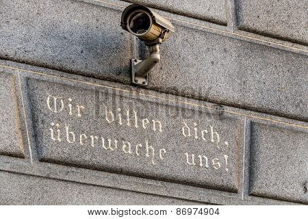 surveillance camera on a building, symbol of monitoring, home security, control, data protection