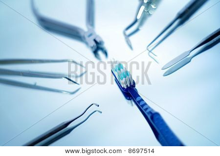 Toothbrush surrounded by dental instruments