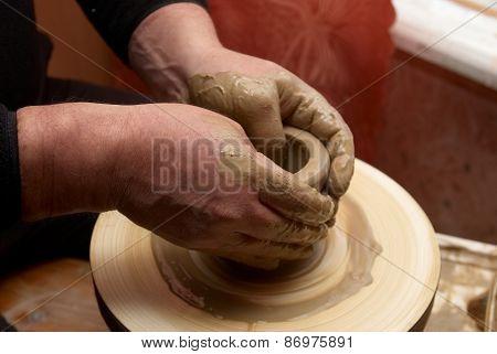 Hands Forming Clay Pot