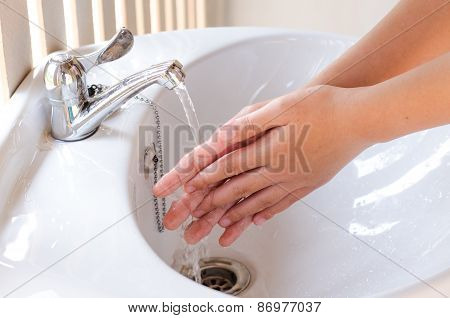Hands Under Stream Of Water From Faucet