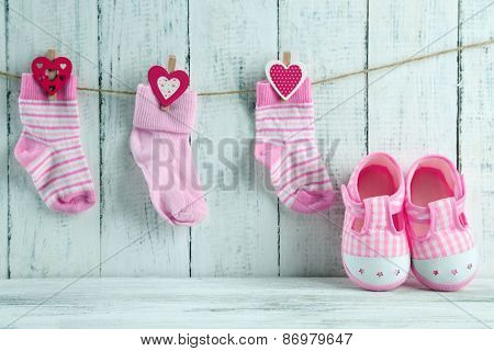 Cute toddler shoes on wooden background