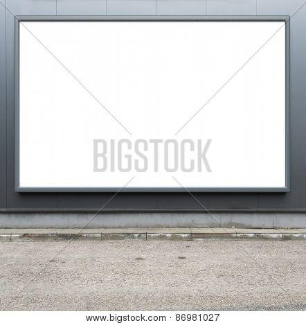 Blank advertising billboard on a street wall.