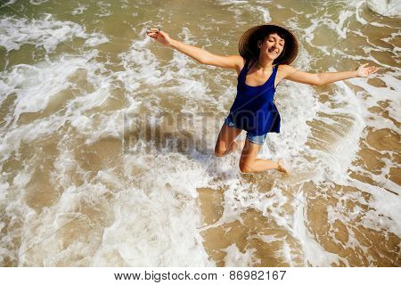 Girl In Vietnamese Hat On The Beach Top View