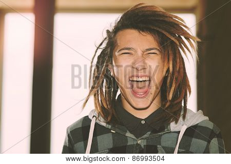 Portrait Of Young Guy  With Rasta Hair Warm Filter Applied
