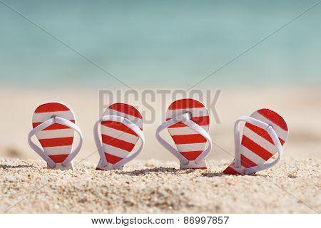 Striped Flip-flops On Beach